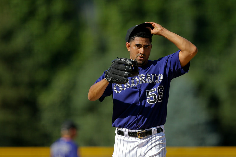 . Starting pitcher Franklin Morales #56 of the Colorado Rockies reacts after giving up a three-run home run to Hunter Pence (not pictured) of the San Francisco Giants during the first inning at Coors Field on September 1, 2014 in Denver, Colorado. (Photo by Justin Edmonds/Getty Images)