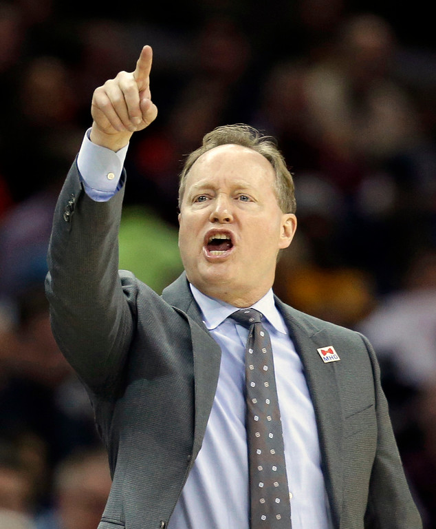 . Atlanta Hawks head coach Mike Budenholzer yells instructions to players in the second half of an NBA basketball game against the Cleveland Cavaliers, Friday, April 7, 2017, in Cleveland. (AP Photo/Tony Dejak)