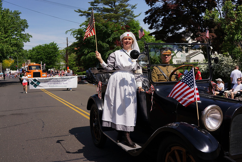 . A woman dressed as a WWI nurse participates in the annual Memorial Day Parade on May 26, 2014 in Fairfield, Connecticut. Across America towns and cities will be celebrating veterans of the United States Armed Forces and the sacrifices they have made. Memorial Day is a federal holiday in America and has been celebrated since the end of the Civil War.  (Photo by Spencer Platt/Getty Images)
