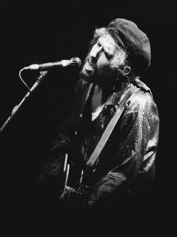 . American singer Bob Dylan performs with Tom Petty and the Heartbreakers during his first concert in Israel, Sept. 6, 1987 in Tel Aviv. The crowd was estimated to be 40,000.  (AP Photo/Anat Givon)
