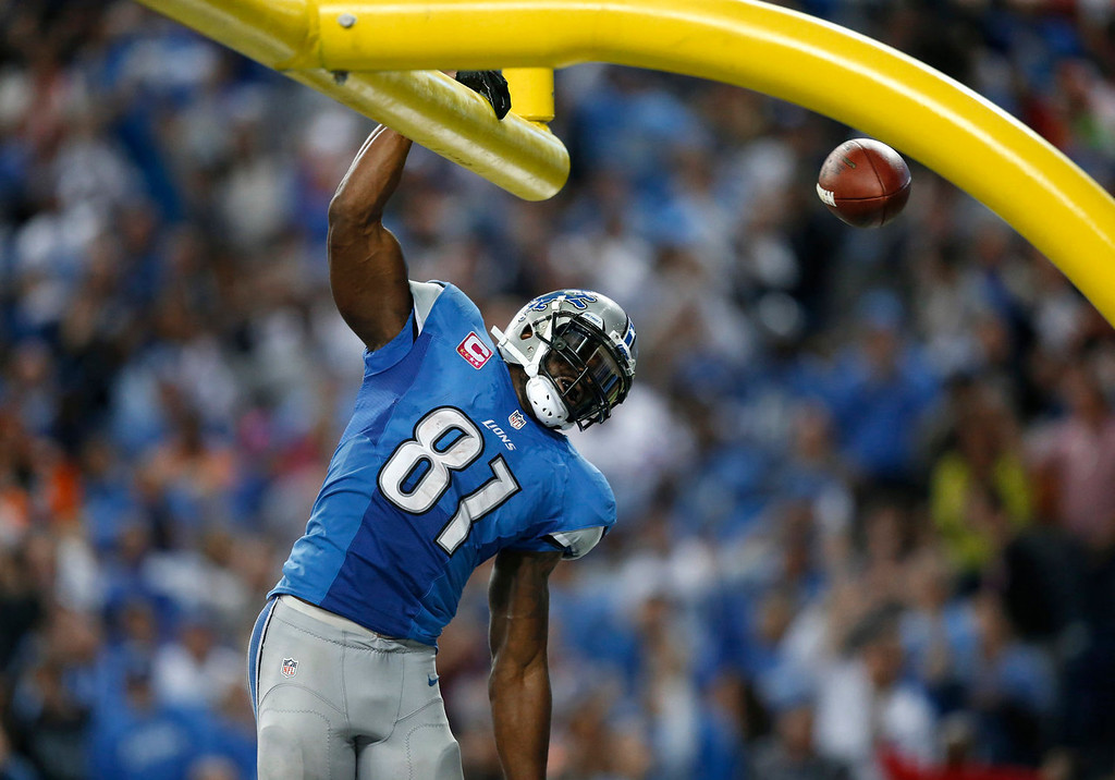 . Detroit Lions wide receiver Calvin Johnson (81) celebrates his 50-yard touchdown reception against the Cincinnati Bengals in the fourth quarter of an NFL football game against Sunday, Oct. 20, 2013, in Detroit. (AP Photo/Rick Osentoski)