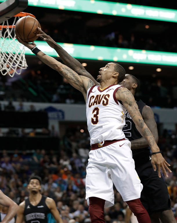 . Cleveland Cavaliers\' George Hill (3) drives past Charlotte Hornets\' Marvin Williams (2) during the second half of an NBA basketball game in Charlotte, N.C., Wednesday, March 28, 2018. (AP Photo/Chuck Burton)