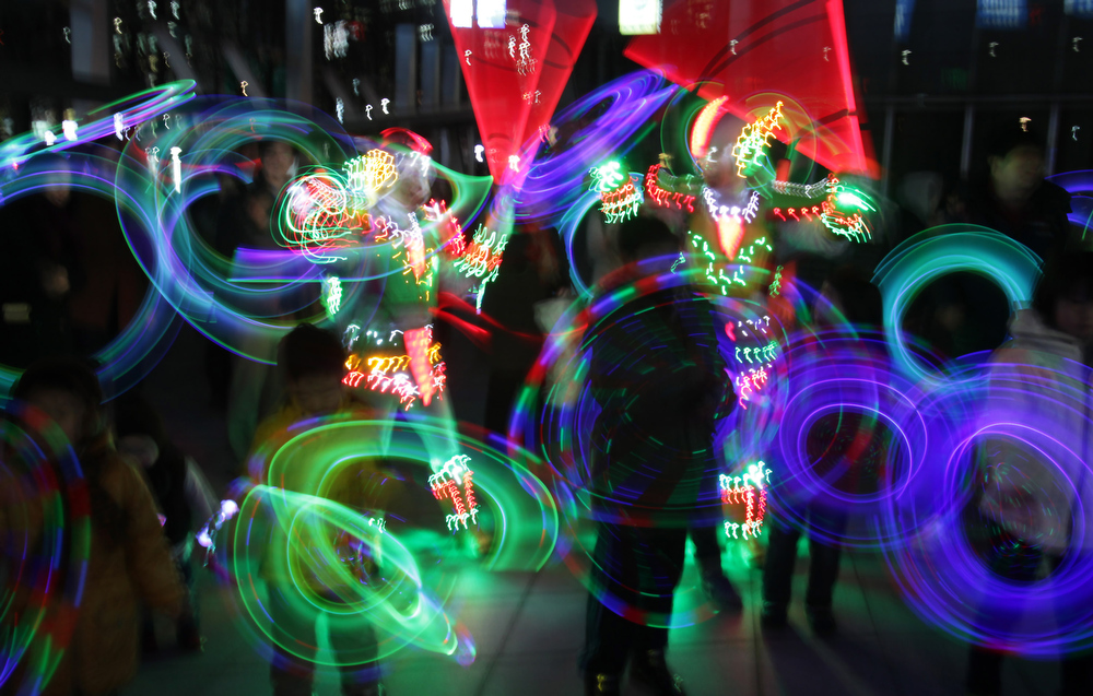 . South Koreans spin illuminated sticks during \'Cyber Jwibulnoli\' at Everland on February 21, 2013 in Seoul, South Korea. Jwibulnoli is originally played on the first full moon of the lunar year, that is February 25 this year.  (Photo by Chung Sung-Jun/Getty Images)