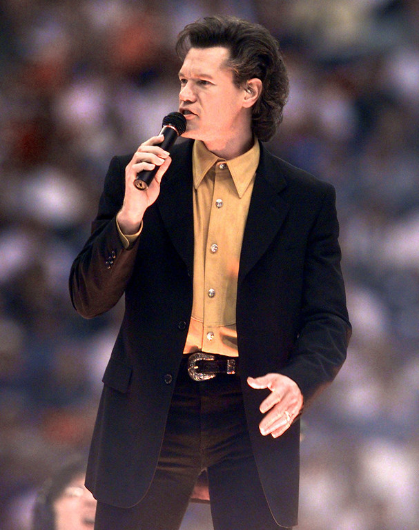 . Country singer Randy Travis performs at half time of the Minnesota Vikings and Dallas Cowboys game in Irving, Texas, Thursday, Nov. 26, 1998. The performance was part of the Salvation Army kick off of their national holiday fundraising campign. (AP Photo/L.M. Otero)