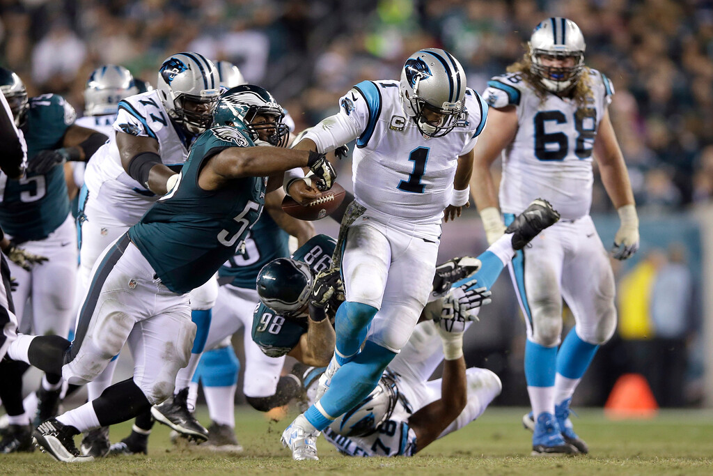 . Carolina Panthers\' Cam Newton (1) fumbles the ball as he is brought down by Philadelphia Eagles\' Connor Barwin (98) and Brandon Graham (55) during the second half of an NFL football game, Monday, Nov. 10, 2014, in Philadelphia. (AP Photo/Michael Perez)