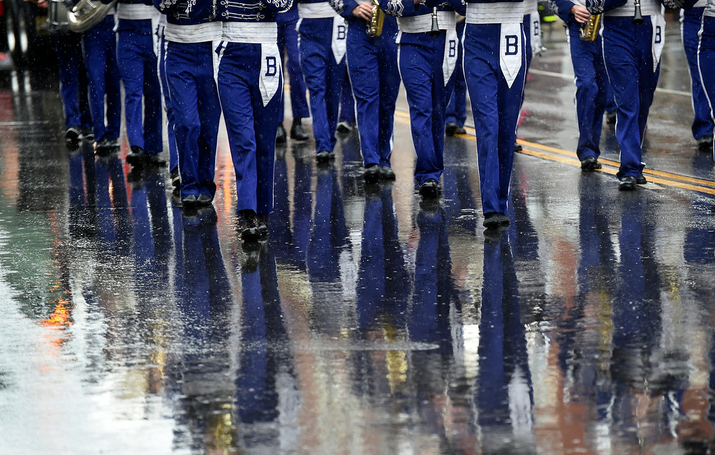 . Kayla Rice/Reformer Members of the Brattleboro Union High School band are reflected in the wet pavement while they march in the Fourth of July parade in Brattleboro on Friday.