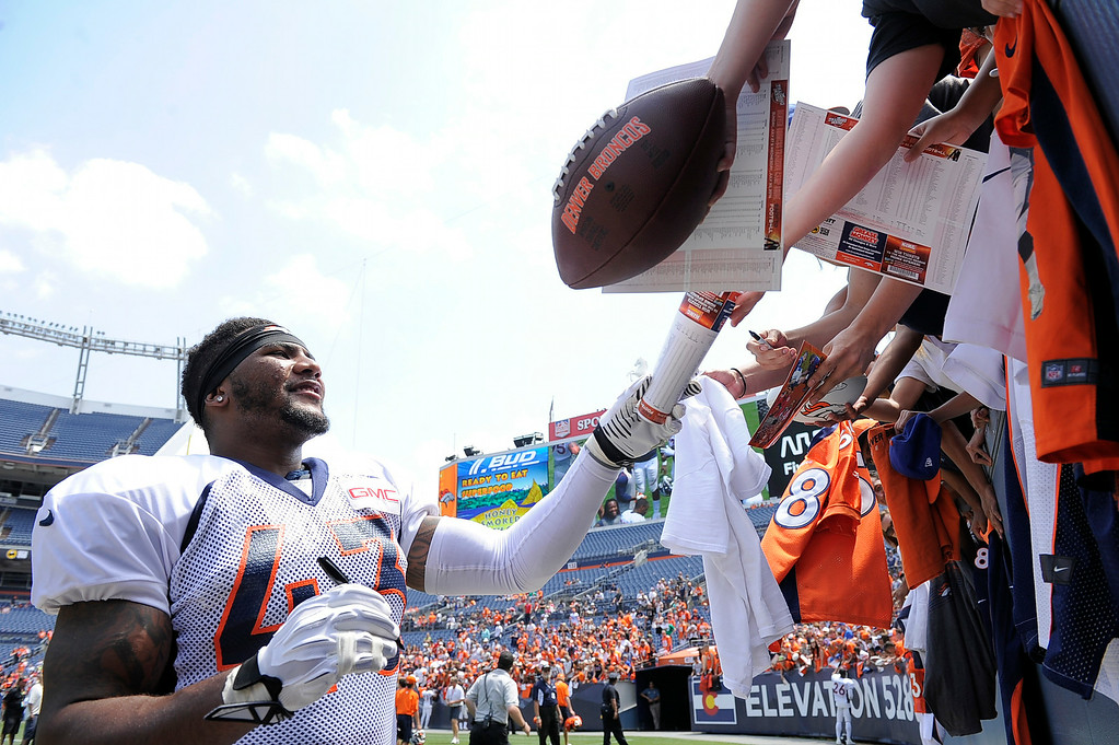 . Denver Broncos strong safety T.J. Ward (43) signs autographs after practice on day four of the Denver Broncos 2014 training camp July 27, 2014 at Sports Authority Field at Mile High. (Photo by John Leyba/The Denver Post)