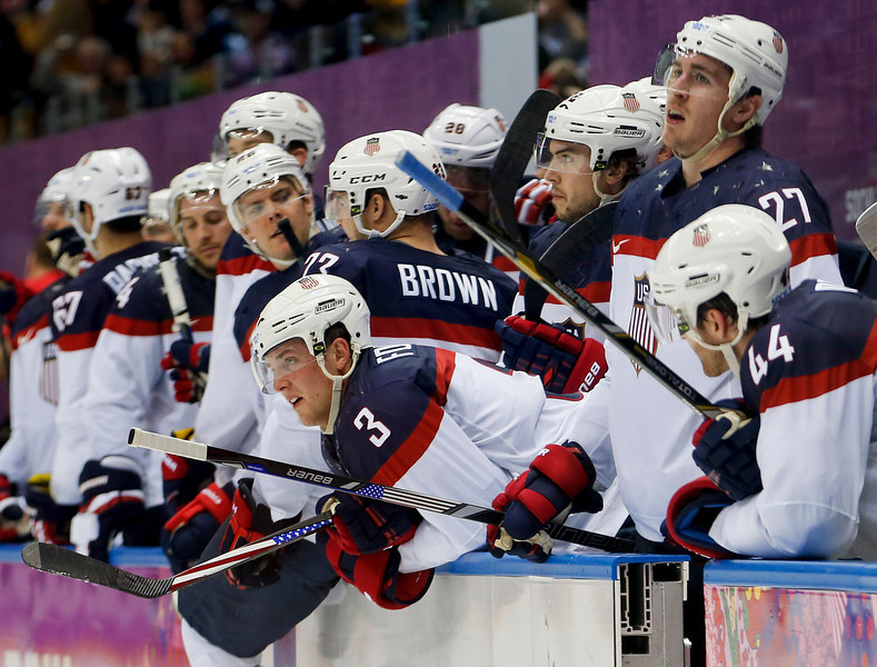 . Team USA watches late in the third period against Canada during a men\'s semifinal ice hockey game at the 2014 Winter Olympics, Friday, Feb. 21, 2014, in Sochi, Russia. Canada won 1-0. (AP Photo/Petr David Josek)