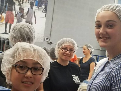 Volunteering at the Feed My Starving Children (June 2018)