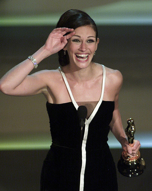 ". Actress Julia Roberts celebrates her Oscar win for Best Actress for her role in ""Erin Brokovich\"" at the 73rd Annual Academy Awards at the Shrine Auditorium in Los Angeles, CA, 25 March, 2001.  TIMOTHY A. CLARY/AFP/Getty Images"
