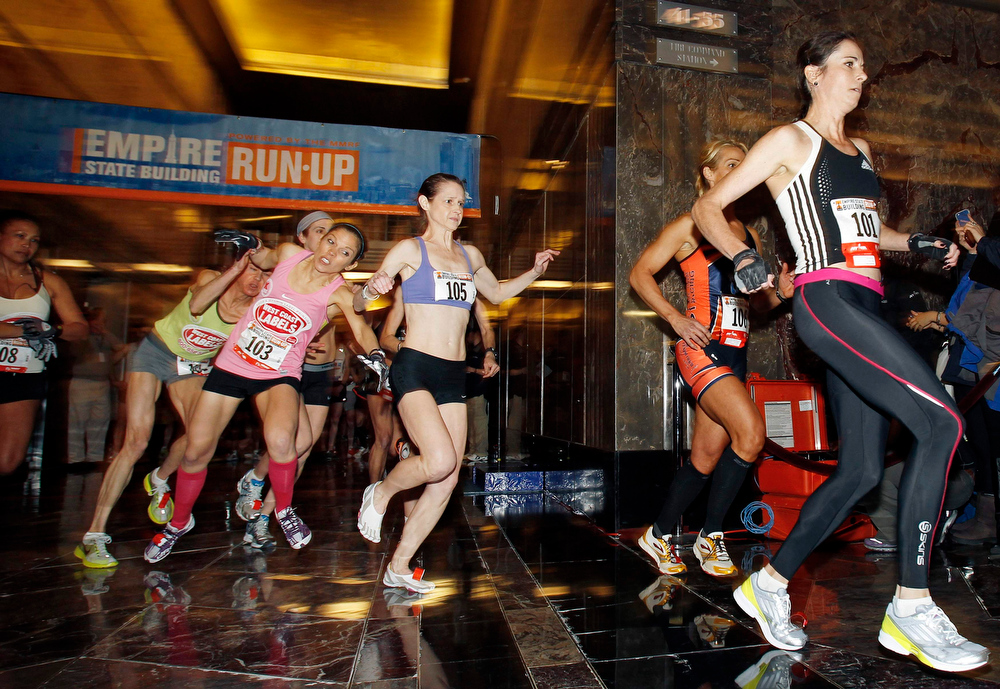 . Women\'s invitational runners participate during the start of the 36th Empire State Building Run-Up running race in New York, February 6, 2013. Competitors run up 1,576 steps and 1,050 feet in a stairwell from the ground floor to the 86th floor observation deck.   REUTERS/Adam Hunger