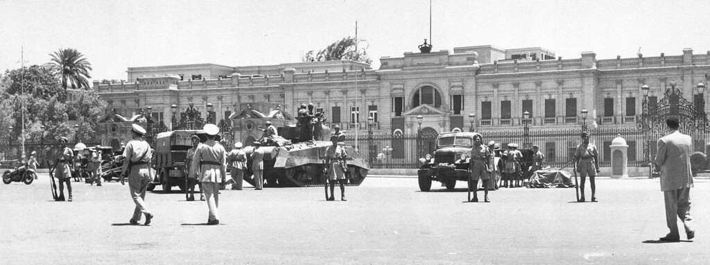 . During a coup d\'etat led by General Muhammed Naguib, an Egyptian army tank and field guns are drawn up in front of the royal  Abdin Palace, in Cairo, on July 26, 1952.  Appointed Premier Ali Maher Pasha issued an ultimatum to King Farouk I, forcing the Egyptian monarch to abdicate. (AP Photo)