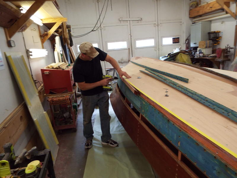 Installing the new starboard chine cap.