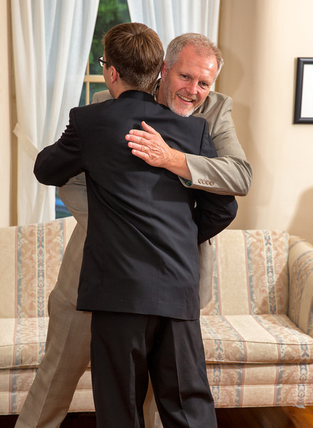 Father of the bride hugging groom.jpg