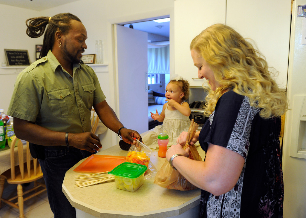 . DENVER, CO - JUNE 25: Laura and Keenon Stillman are joined by their children for a summer meal outside in the family backyard. Laura and Keenon begin their dinner preparation in the kitchen with the help of granddaughter Aspen,1. (Photo By Kathryn Scott Osler/The Denver Post)