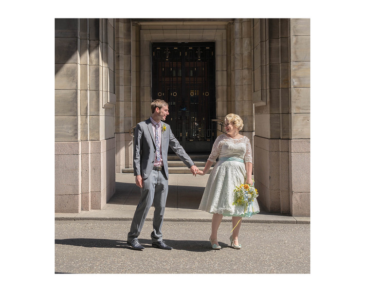 Wedding Photography of Blair & Adam, Glasgow, Photograph is of the Bride pulling the groom towards the reception