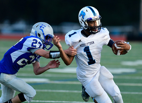 9/14/2018 Mike Orazzi | Staff Bristol Eastern's Carson Sassu (27) and Middletown's Jonta'e Dempsey-Brown (1) during Friday night's football game with Middletown in Bristol.