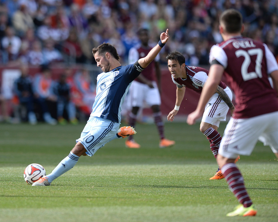 . Kansas City midfielder Benny Feilhaber (10) took a shot in the first half. The Colorado Rapids hosted Sporting Kansas City Saturday evening, March 29, 2014 at Dick\'s Sporting Goods Stadium in Commerce City.  (Photo by Karl Gehring/The Denver Post)