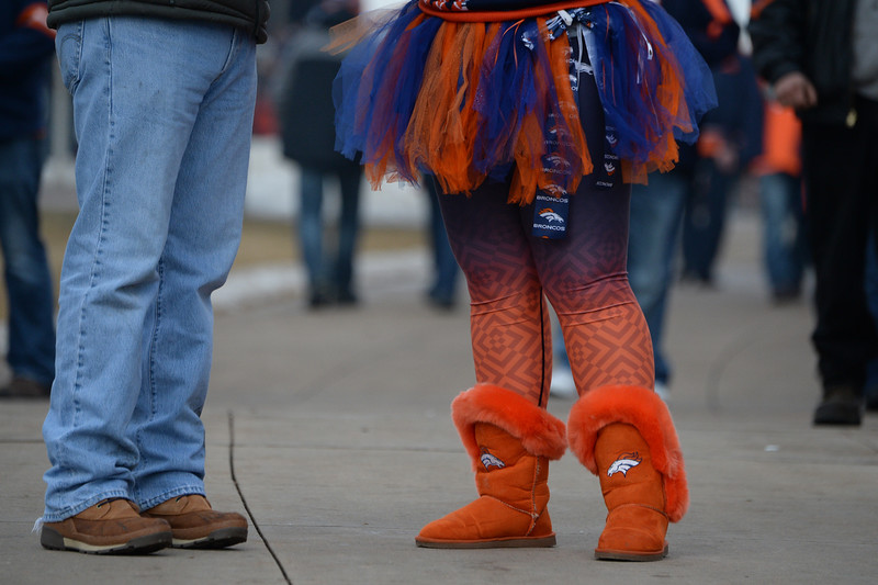 . Cayla Craig, of Greeley, tailgates before the game. The Denver Broncos played the Indianapolis Colts in an AFC divisional playoff game at Sports Authority Field at Mile High in Denver on January 11, 2015. (Photo by Craig F. Walker/The Denver Post)
