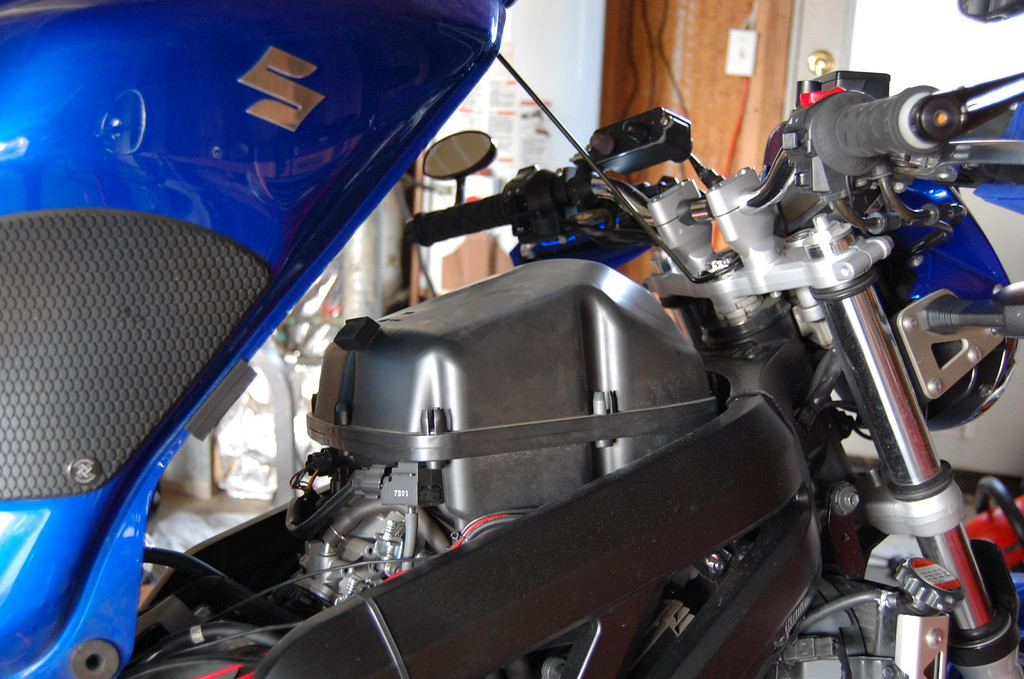 sv650 with gas tank propped up and airbox exposed