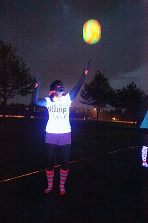 Jackson Township residents Shelby Richards serves the ball under black lights in a match at Jackson Township Parks and Recreation second, black light volleyball tournament this summer for girls grades 6-9 on Friday, July 30, 2009, Ohio. Photo By LewStamp, PhotoStamp@sbcglobal.net