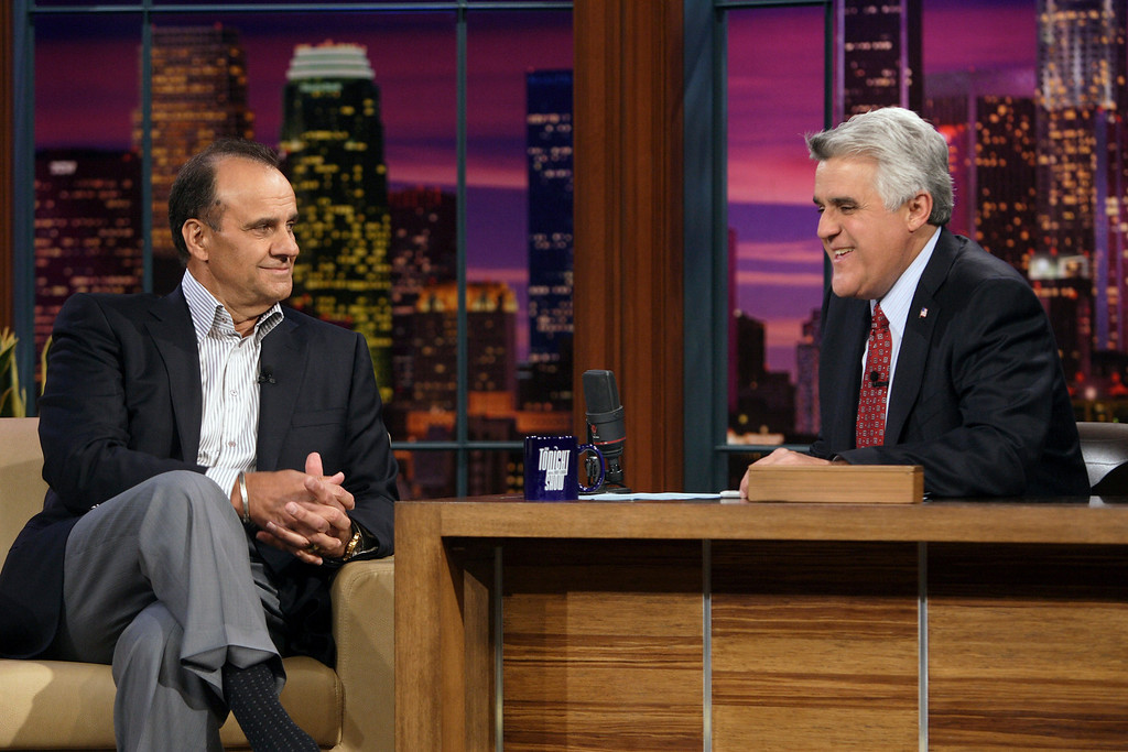 """. In this photo provided by NBC, Los Angeles Dodgers manager Joe Torre, left, talks to host Jay Leno during his appearance on \""""The Tonight Show with Jay Leno\"""" on Wednesday, March 26, 2008 in Los Angeles. (AP Photo/NBC, Margaret Norton) **NO SALES, NO ARCHIVE**"""