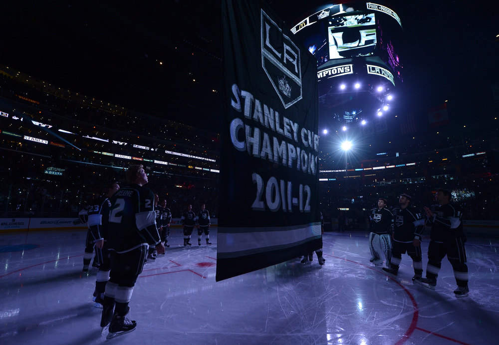 Description of . LOS ANGELES, CA - JANUARY 19:  The Los Angeles Kings 2001-12 Stanley Cup banner is raised during a ceremony before the NHL season opening game against the Chicago Blackhawks at Staples Center on January 19, 2013 in Los Angeles, California.  (Photo by Harry How/Getty Images)