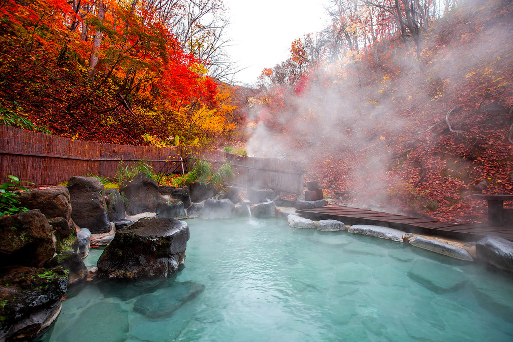 Outdoor bath at Japanese onsen. Editorial credit: Dpongvit / Shutterstock.com