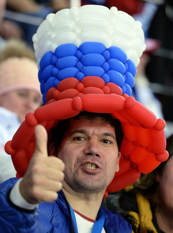 . A Russian fan gestures during the Women\'s Ice Hockey Group A match USA vs Canada at the Shayba Arena during the Sochi Winter Olympics on February 12, 2014.  AFP PHOTO / ANDREJ ISAKOVICANDREJ ISAKOVIC/AFP/Getty Images
