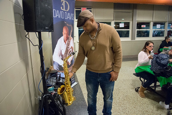 01/30/20 Wesley Bunnell | StaffrrThe annual SOUPerBowl to benefit the Friendship Centers Soup Kitchen took place on Thursday Jan 30, 2020 at E.C. Goodwin Technical School. Musician David Davis keeps the music playing while not playing the saxophone for the attendees.