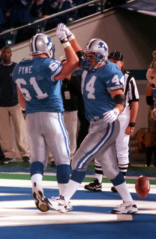 . Tommy Vardell (44) and Jim Pyne (61) of the Detroit Lions celebrate after Vardell scored a short touchtown run in the first quarter against the Chicago Bears at the Pontiac Silverdomw.