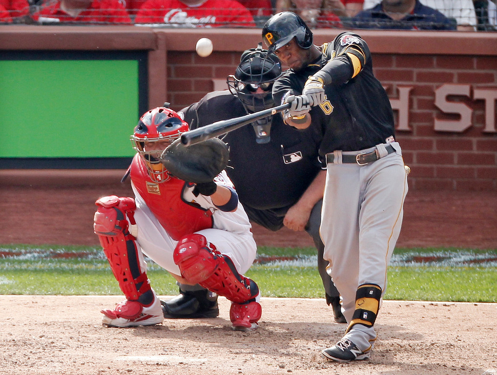 . Pittsburgh Pirates\' Starling Marte (6) hits a solo home run against the St. Louis Cardinals in the eighth inning of Game 2 of baseball\'s National League division series on Friday, Oct. 4, 2013, in St. Louis. (AP Photo/Sarah Conard)