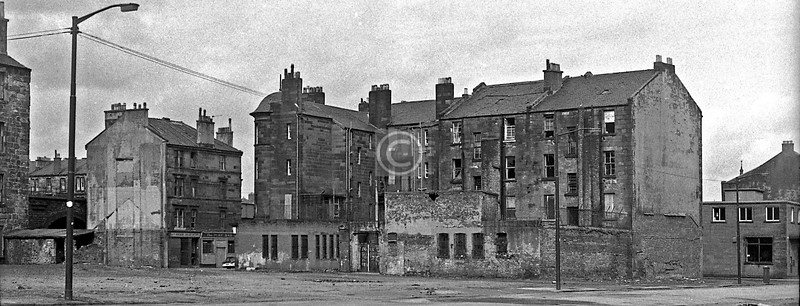 From Thistle St, with a bit of Hospital St (Pearl Bloch's grocery and the Turf Bar) on the left, and the back of one of the City Improvement Trust's tenements which faced on to Rutherglen Rd. March 1973