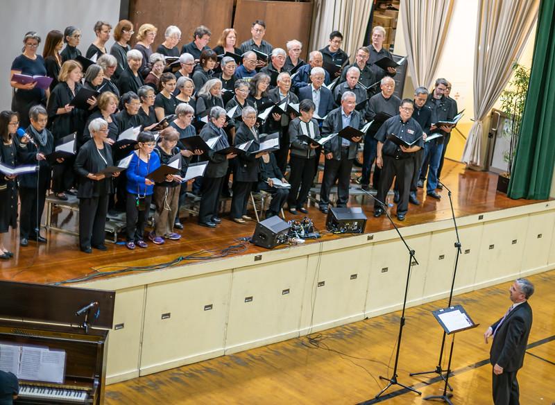 Interfaith choir conducted by Mark Teagle.