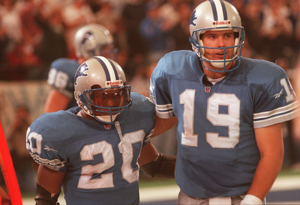 . Barry Sanders gets congrads for QB Scott Mitchell after Sanders ran for15 yards for a TD in the 4th Quarter. Sanders ended his day with 167 yards on 19 carries, three touchdowns and 2nd place on the all time rushing list.