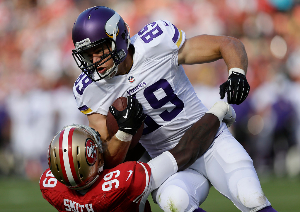 . Vikings tight end John Carlson  is tackled by 49ers linebacker Aldon Smith during the first quarter. (AP Photo/Marcio Jose Sanchez)