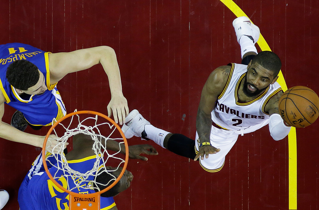 . Cleveland Cavaliers guard Kyrie Irving (2) against the Golden State Warriors in the first half in Game 6 of the NBA basketball Finals, Thursday, June 16, 2016, in Cleveland. (AP Photo/Ron Schwane)
