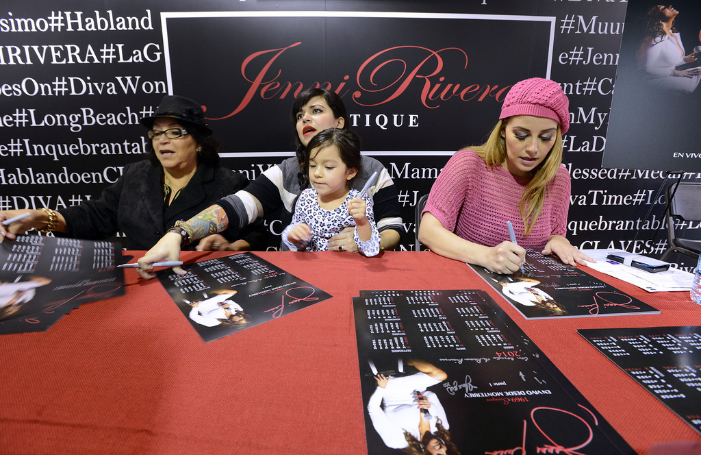 . Dec. 9 marks the one year anniversary of the death of singer Jenni Rivera. From left to right, Mother Rosa Rivera, Daughter of Jenni , Jacqui Rivera and her daughter Kayla and Jenni\'s sister Rosie Rivera sign autographs for fans inside the Jenni Rivera Boutique in Panorama City. Fans were on hand for the release of her new live album, which was recorder just before Jenni\'s death in a  plane crashed in Mexico.  Panorama City Calif., December 3, 2013. 