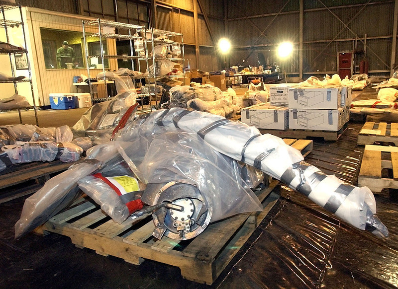 . Large pieces of space shuttle Columbia debris sit wrapped on pallets at Nose Dock Six, Monday Feb. 10, 2003, at Barksdale Air Force Base, La. (AP Photo/Tony Gutierrez, Pool)