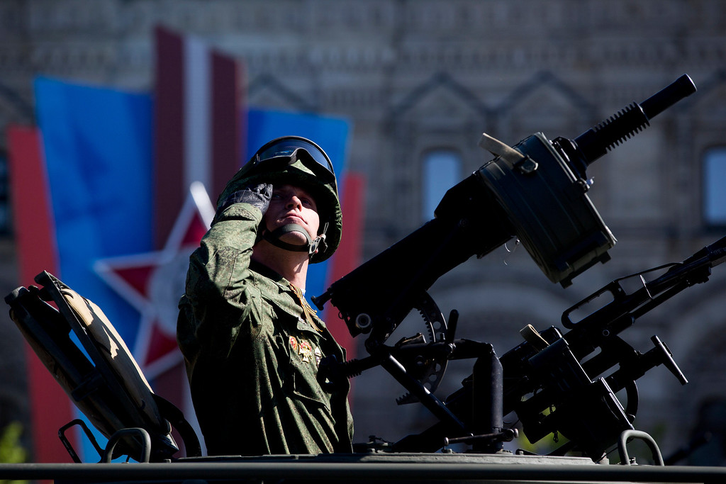 . A Russian soldier salutes during the Victory Day parade in the Red Square in Moscow, Russia, Friday, May 9, 2014.  (AP Photo/Pavel Golovkin)