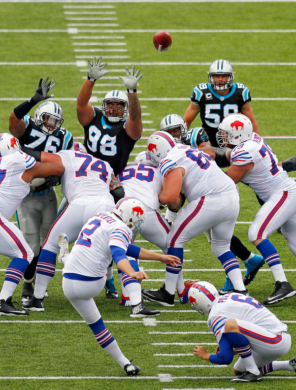 . Buffalo Bills kicker Dan Carpenter (2) kicks a 55-yard field goal over Carolina Panthers\' Greg Hardy (76) and Star Lotulelei (98) in the second quarter of an NFL football game Sunday, Sept. 15, 2013, in Orchard Park, N.Y. (AP Photo/Bill Wippert)