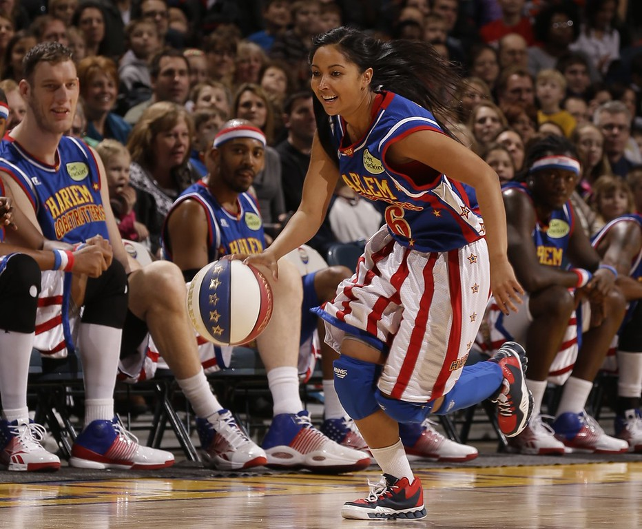 """. Oakland native Tammy Brawner, who plays under the moniker \""""T-Time\"""" returns to the Bay Area as a member of the Harlem Globetrotters, who will perform locally  Jan. 19-20, 2013.  Brawner, the 10th woman in the 87-year history of the famous basketball troupe, will be the only female on thefloor for this leg of the Globetrotters\' tour.Photo courtesy of Harlem Globetrotters"""