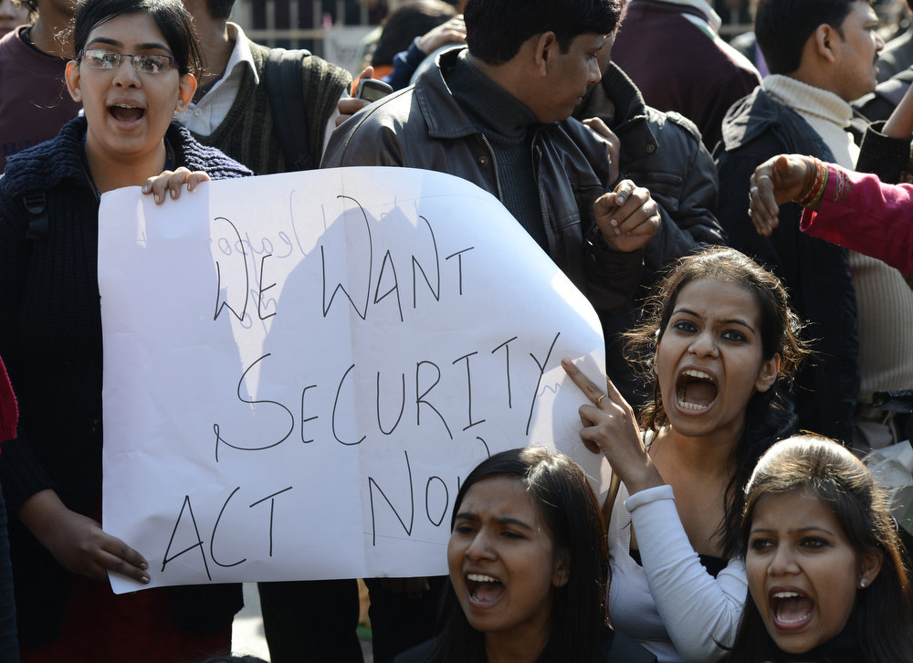 Description of . Indian activists shout slogans outside police headquarters during a protest in New Delhi on December 19, 2012,  following the gang-rape of a student on December 16.  Four people, including the bus driver, have so far been arrested, while a hunt is ongoing for two other suspects. The attack sparked new calls for greater security for women in New Delhi, which registered 568 rapes in 2011 compared with 218 in India's financial capital Mumbai the same year. SAJJAD HUSSAIN/AFP/Getty Images