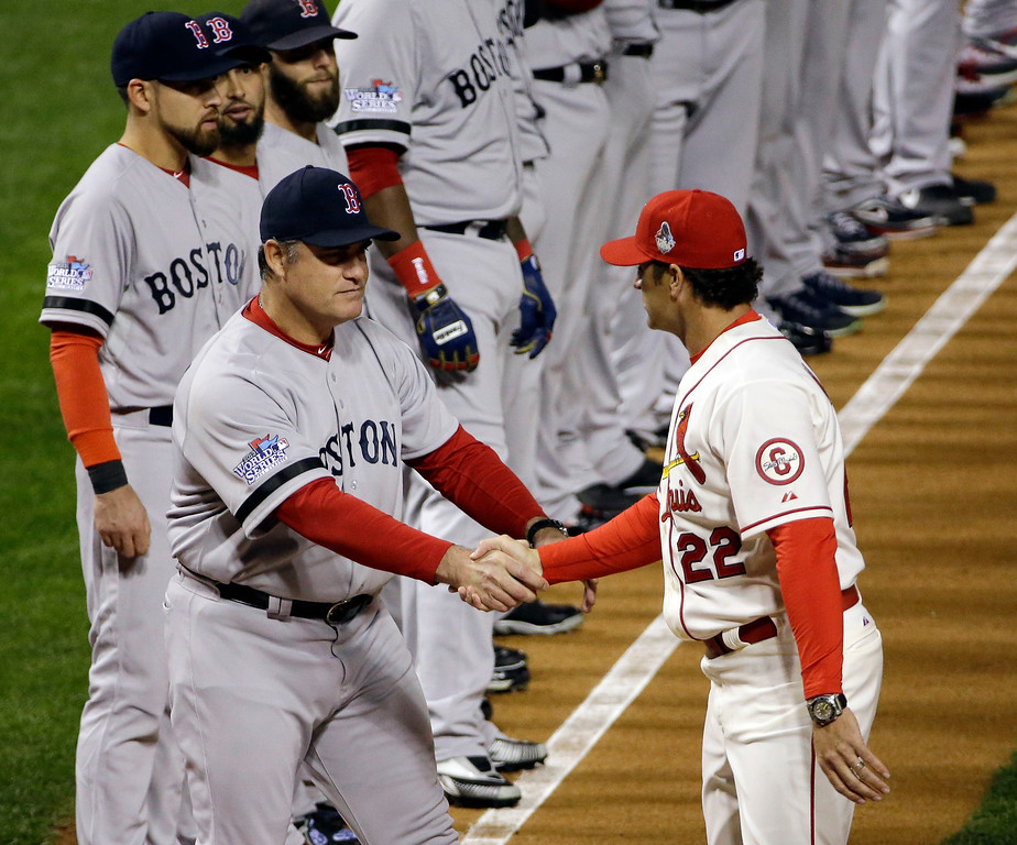 . Boston Red Sox manager John Farrell shakes hands with St. Louis Cardinals manager Mike Matheny before Game 3 of baseball\'s World Series Saturday, Oct. 26, 2013, in St. Louis. (AP Photo/David J. Phillip)