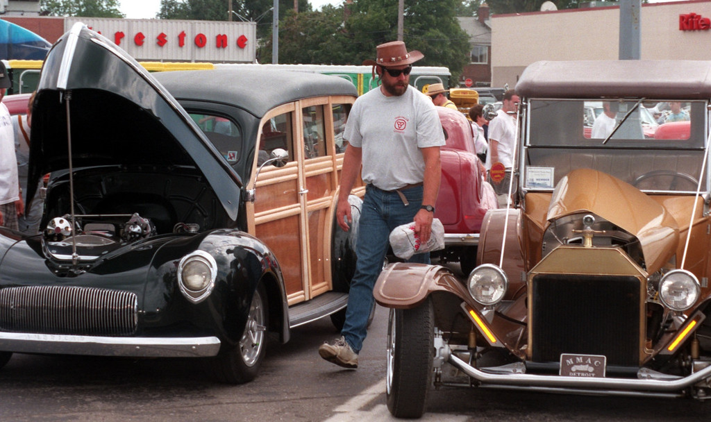 . A car enthusiast looks at a few classic cars in Royal Oak along Woodward Ave. during the Fifth Annual Woodward Dream Cruise.