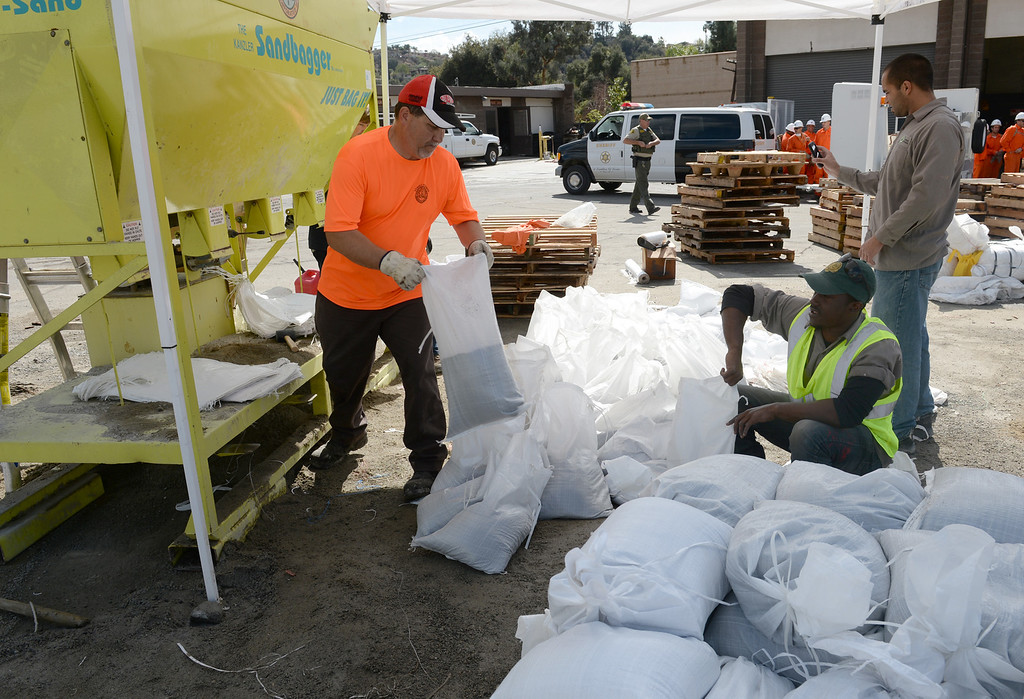 . Workers fill up sandbags at the Glendora City Yard for residents in Glendora on Thursday February 27, 2014. (Staff Photo by Keith Durflinger/San Gabriel Valley Tribune)