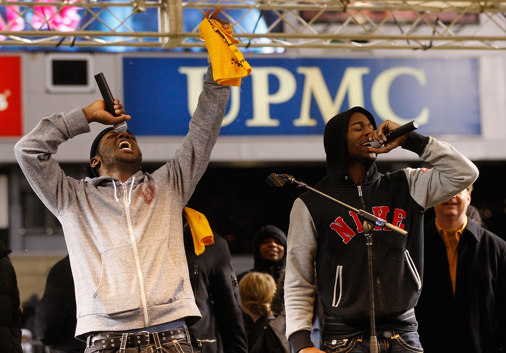 . Antonio Brown #84 (L) and Emmanuel Sanders #88 of the Pittsburgh Steelers talk to fans during the Super Bowl XLV Pep Rally on January 28, 2011 at Heinz Field in Pittsburgh, Pennsylvania.  (Photo by Jared Wickerham/Getty Images)