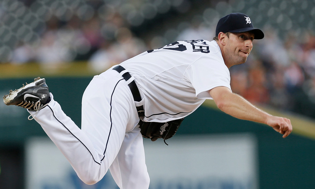 . Detroit Tigers pitcher Max Scherzer throws against the Minnesota Twins in the first inning of a baseball game in Detroit, Thursday, Sept. 25, 2014. (AP Photo/Paul Sancya)