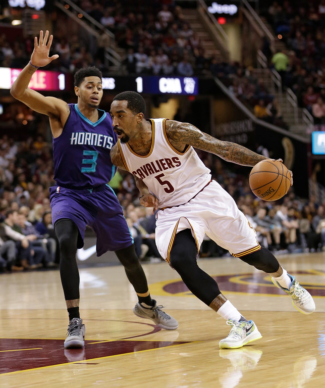 . Cleveland Cavaliers\' J.R. Smith (5) drives to the basket against Charlotte Hornets\' Jeremy Lamb (3) in the first half of an NBA basketball game Wednesday, Feb. 24, 2016, in Cleveland. (AP Photo/Tony Dejak)