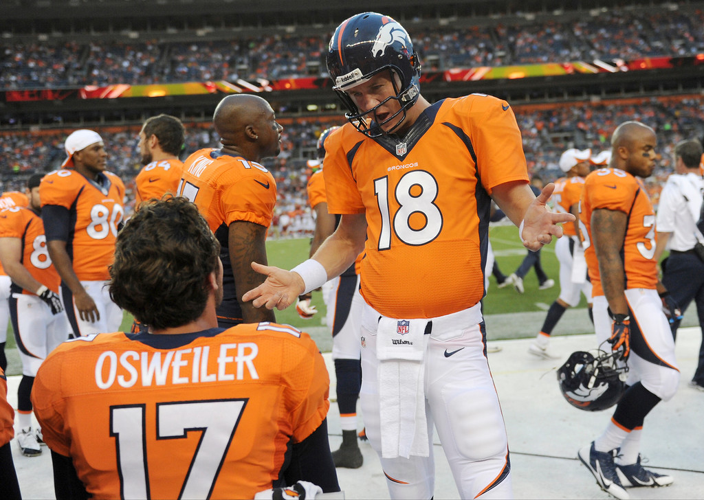 . Peyton Manning (18) of the Denver Broncos speaks with Brock Osweiler (17) on the sidelines against the Arizona Cardinals during the last pre-season game of the season at Sports Authority Field at Mile High. August 29, 2013 Denver, Colorado. (Photo By Joe Amon/The Denver Post)